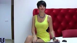 Brunette Poochie in yellow dress